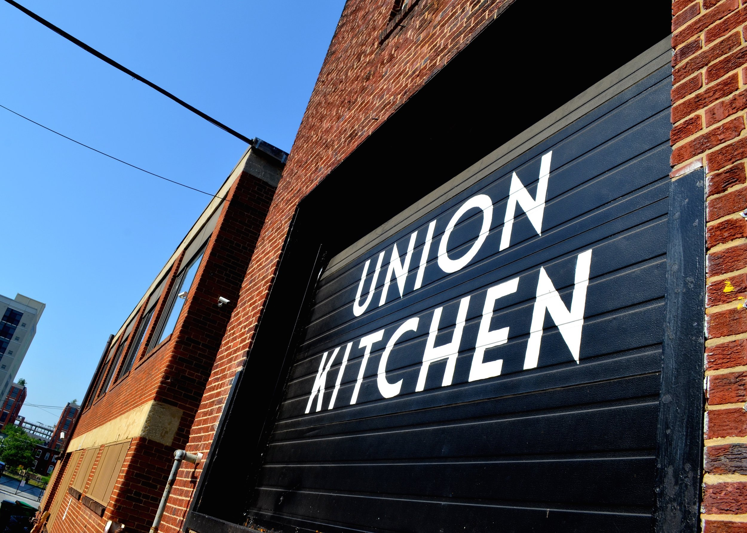 Copy+of+Union+Kitchen+garage+door,+blue+sky+in+the+background-+Rebecca+Dickerson+(1)+(1)